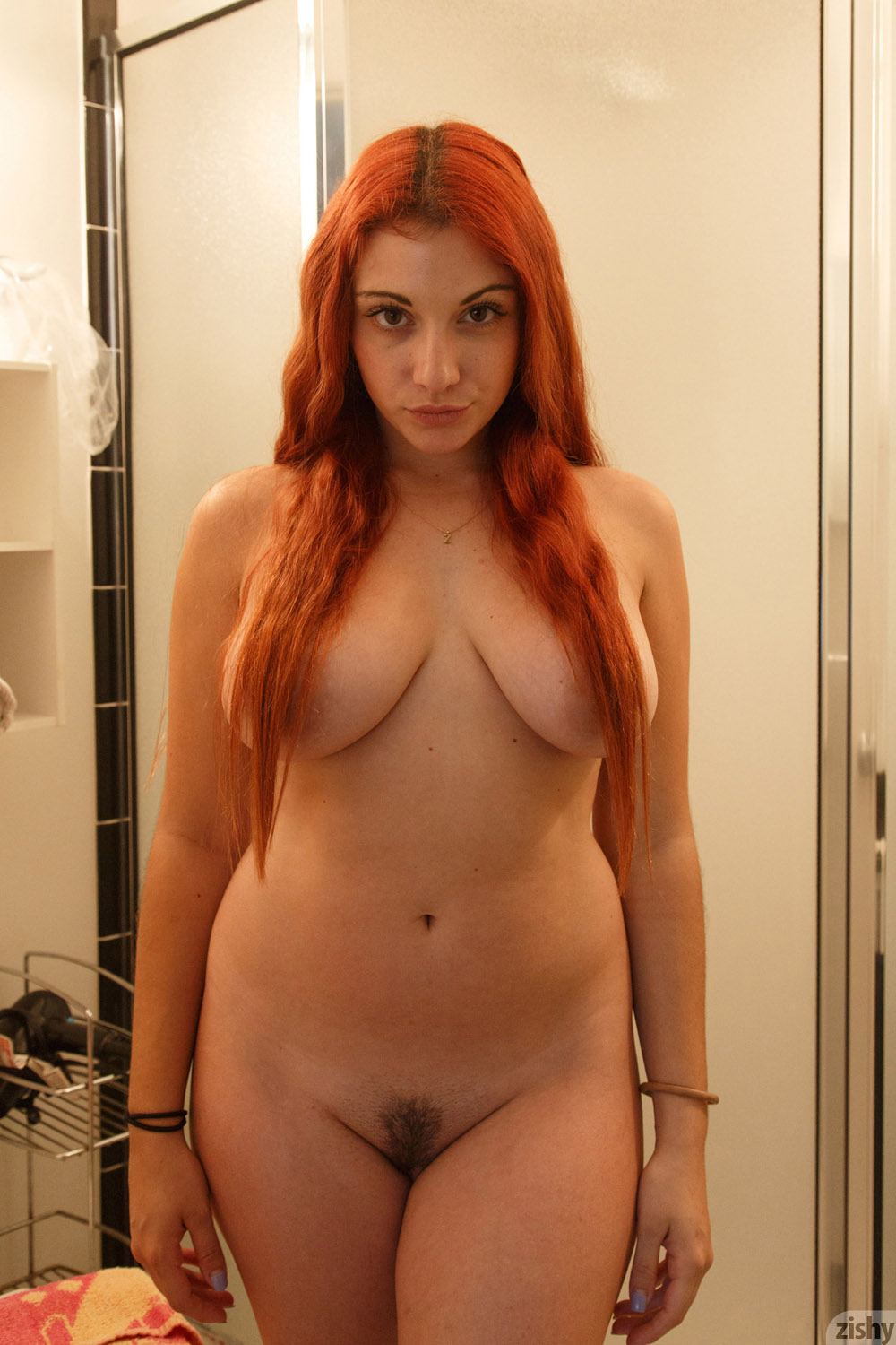 Watch Curvy Redhead Gets Naked And Plays With Her Pussy On Webcam