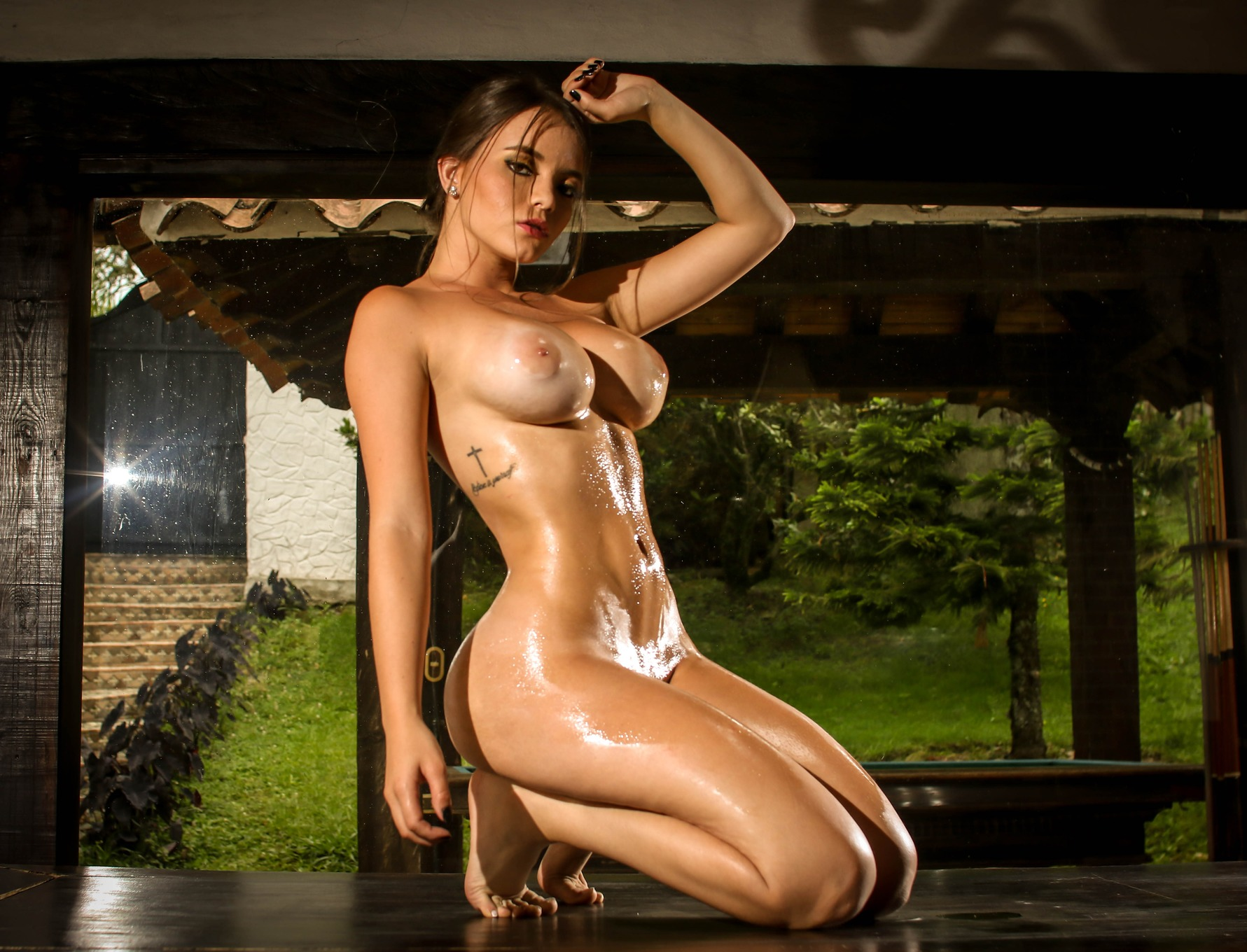 Sexy Woman With Perfect Body Getting Oiled Up
